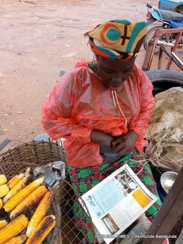 63-year-old Funke Agboola, who sells roasted maize