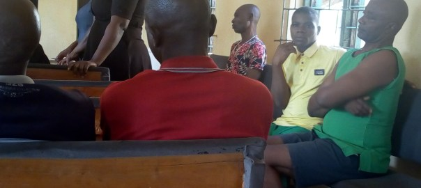 Mr Ogbuja, sitting to the far right, is awaiting the start of trial.