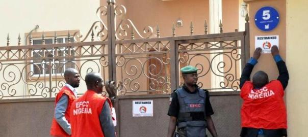 EFCC officials sealing up a building under investigarion