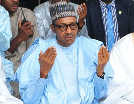 President Muhammadu Buhari pictured during a prayer session [Photo: tribuneonlineng.com]