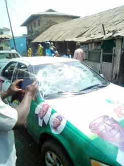 Some of the vehicles damaged by the PDP thugs at Ile Aiyelabegan, a spit distance from the Senate president's homestead in Agbaji in Ilorin West.