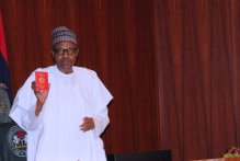 President Muhammadu Buhari, receiving the sample of the New Enhanced Security e-Passport during the official launch of the passport at the Presidential Villa in Abuja on Tuesday (15/01/2019).