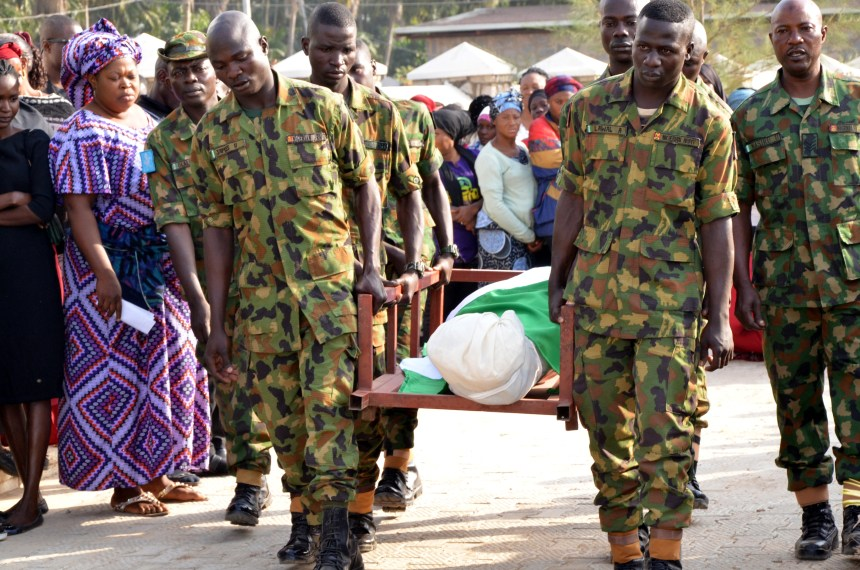 Soldiers carrying the remains of their dead colleagues during the burial of 14 Nigeria military personnel who lost their lives in an ambush by Boko Haram on Damaturu-Maiduguri Highway in Kaduna on Friday 11/1/2019 00304/11/01/2019/Ibrahim Bashir/ICE/NAN