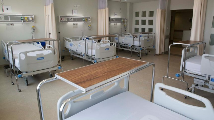 Hospital beds used to illustrate the story.