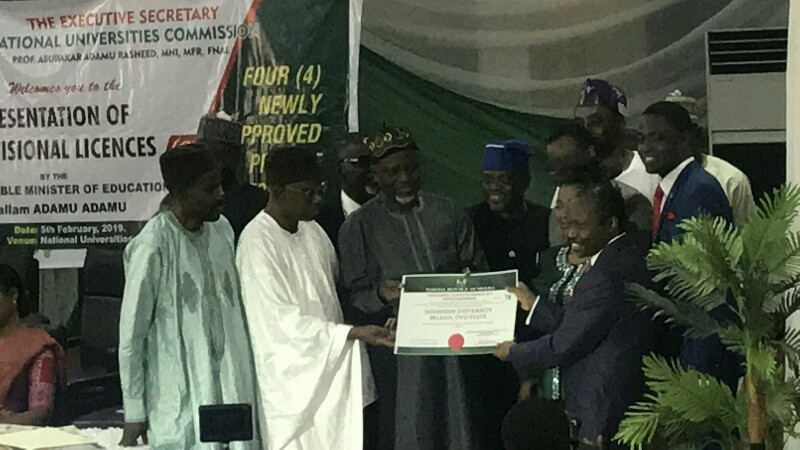 The Executive Secretary NUC, Abubakar Rasheed, the registrar JAMB, Ishaq Oloyede presenting the license to the Proprietors of Dominion University.