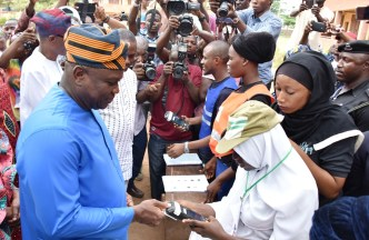 Lagos State Governor, Mr. Akinwunmi Ambode, being accredited during the Presidential and NASS Elections at Ward A5 Polling Unit 033, Ogunmodede College, Papa, Epe, on Saturday, February 23, 2019.