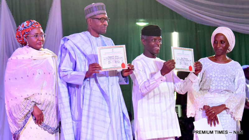 From left: Wife of the President, Aisha Buhari; President Muhammadu Buhari; Vice President Yemi Osinbajo; and wife of the Vice President, Dolapo Osinbajo, during presentation of Certificate-of-Return to Buhari and Osinbajo as winners of 2019 Presidential election, by Chairman of INEC, Prof. Mahmood Yakubu (L), at the International Conference Centre in Abuja on Wednesday (27/2/19). 01781/27/2/2019/Callistus Ewelike/HB/BJO/NAN