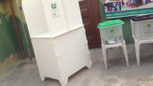 @9:22 Ward 01 PU 011 Shomolu Lga Lagos East. One of the ballot boxes leaking and INEC officials use paper to block it.