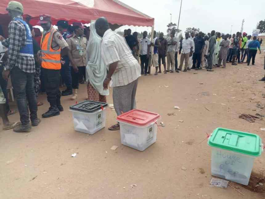 A voter at PU 014, Nyanya (Under bridge), Abuja.