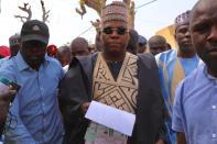 Governor Kashim Shettima of Borno state casting his vote his poling uni, Alhaji Kukawa, Lamisula Jabbamari/Lamisula ward of Maiduguri.