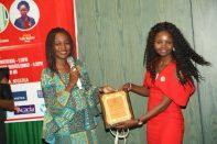 Faith Mutheu from Kenya receiving an award at the 2018 Awards