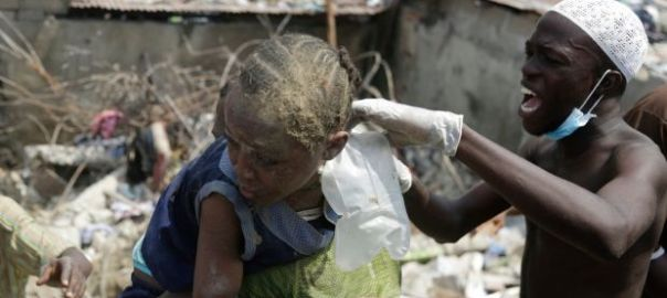 A child (in blue top) is pulled from the rubble of a collapsed school building in Lagos, Nigeria, on Wednesday. Photograph: Sunday Alamba/AP Photo