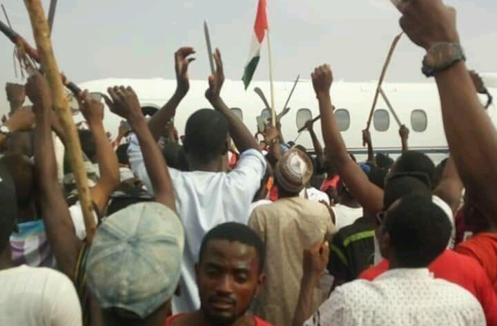 Suspected PDP hoodlums waiting the arrival of Governor Dankwambo, before the mayhem.