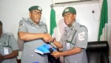 Bashir Abubakar (R) handing over to Mohammed Abba-Kura (L)