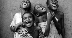 Photo of some happy Nigerians laughing used to illustrate story[PHOTO CREDIT: lists.ng]