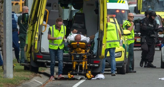 First respondents attending to an injured victim of the New Zealand mosque shootings [Photo: Daily Sabah]