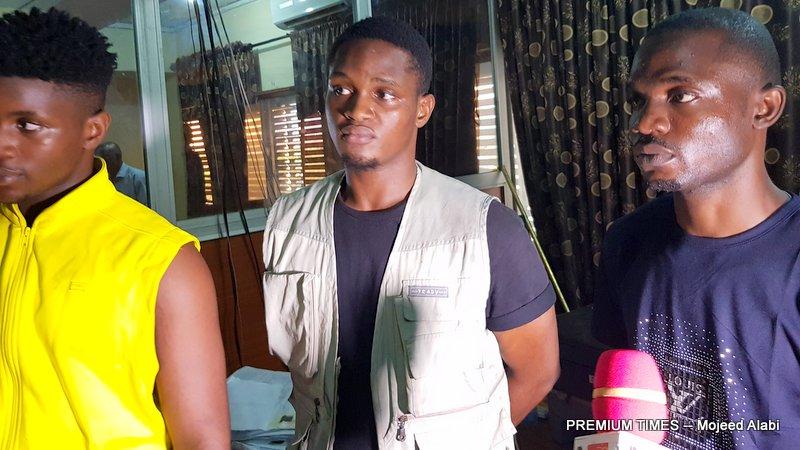 L-R: David, Godswill and Obinna during their arrest in Lagos. (Photo: Mojeed Alabi)