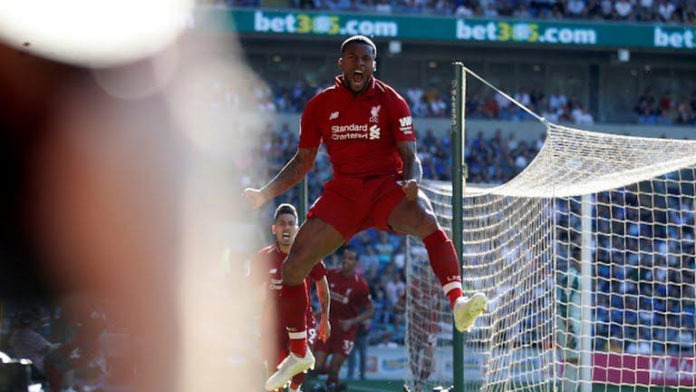 Georginio Wijnaldum celebrates after scoring for Liverpool (Photo Credit: Reuters)