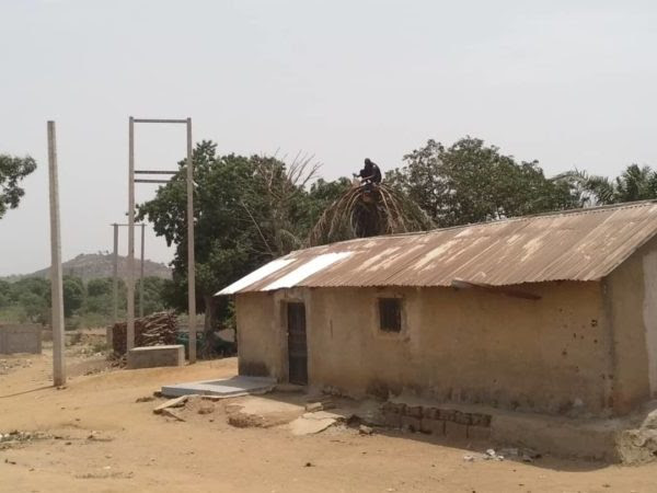 Gosa Kpanyi Kpanyi community with electricity poles without wires.