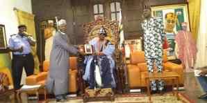 Nasirudeen Usman, leader of the NIPSS delegation presenting honorary award to Rilwan Akiolu, the Oba of Lagos.