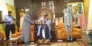 Nasirudeen Usman, leader of the NIPSS delegation presenting honorary award to Rilwan Akiolu, the Oba of Lagos.