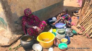 9 year old Shafa and her sister Nafisat washing plate during school hour.