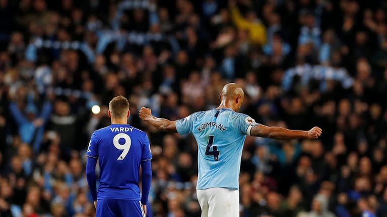 Kompany celebrates after the match