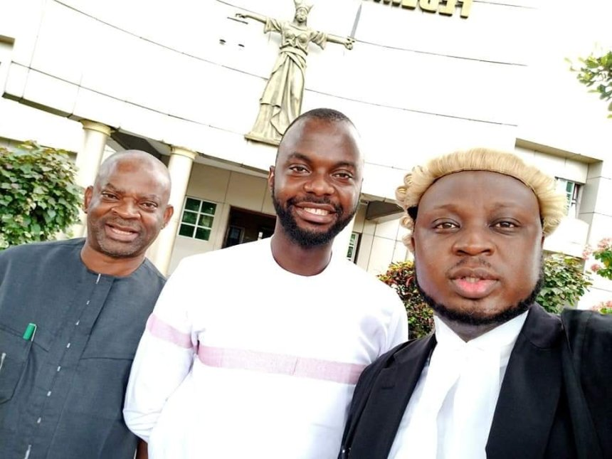 The blogger, Morgan Ukpong (middle) with his lawyer, Mr Ewa Okpo (right), after the court dismissed the case against him