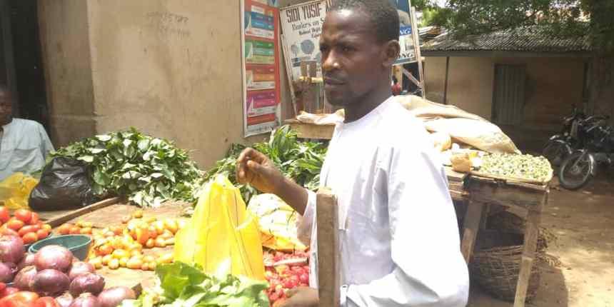 Sa'idu Ali, Vegetable seller, Tradermoni beneficiary at Yan Tipper market in Dutse, Jigawa State.