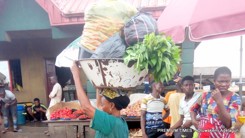 Female porter in Tomato Field, Mile 12, Lagos