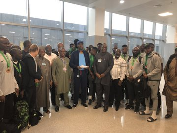 The Nigerian team in a group photograp with the SGF, Boss Mustaph at the Nnamdi Azikiwe Int'l Airport, Abuja