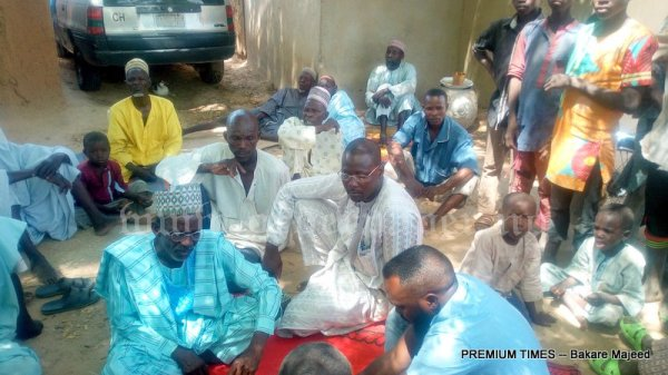 Sitting with affected farmers in Garin Mallam
