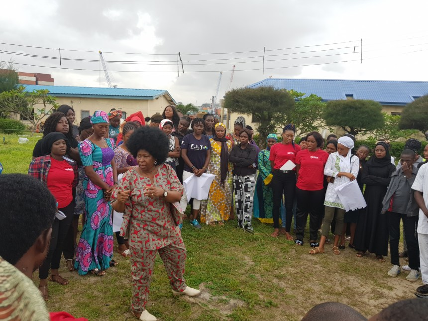 Ene Obi surrounded by the participants during a training session