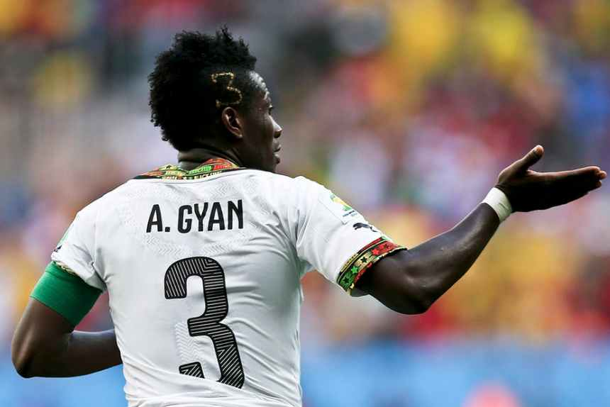 Ghana player Asamoah Gyan celebrates a goal against Portugal during a 2014 FIFA World Cup match in Brazil. EPA/Jose Sena Goulao
