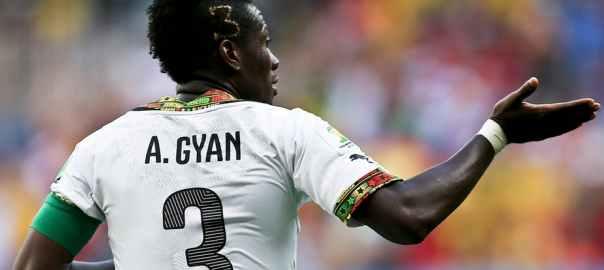 Ghana player Asamoah Gyan celebrates a goal against Portugal during a 2014 FIFA World Cup match in Brazil. EPA/Jose Sena Goulao