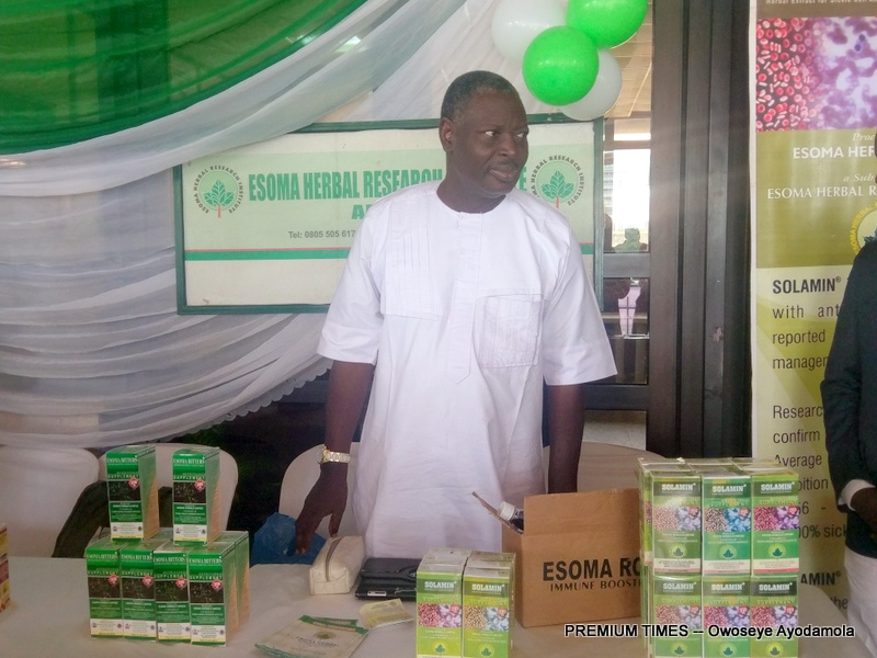 A traditional herbal medicine practitioner exhibiting his ware at the event