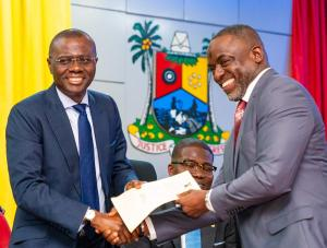 Lagos State Governor, Mr. Babajide Sanwo-Olu (left), congratulating Engr. Olalekan Shodeinde as the new Permanent Secretary, Office of Drainage Services during the swearing-in ceremony of nine permanent secretaries at Lagos House, Alausa, Ikeja, on Monday, August 19, 2019. With them is the Head of Service, Mr. Hakeem Muri-Okunola.