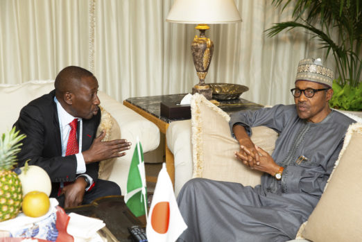 President Muhammadu Buhari chats with NSA Major General Babagana Monguno on arrival for the 7th Tokyo International Conference on African Development in Japan. PHOTO; SUNDAY AGHAEZE. AUG 26 2019.