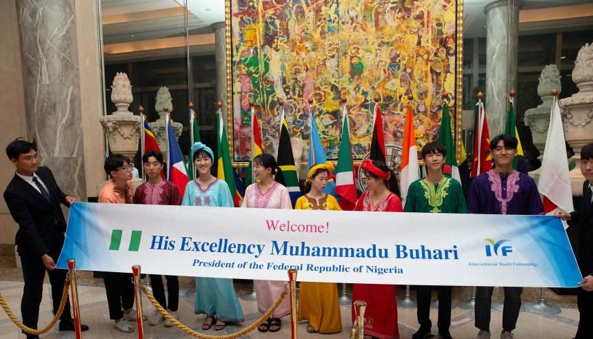PRESIDENT BUHARI ARRIVED JAPAN FO1R TICAD. Members of International Youth Fellowship welcomes President Muhammadu Buhari on arrival for the 7th Tokyo International Conference on African Development in Japan. PHOTO; SUNDAY AGHAEZE. AUG 26 2019.