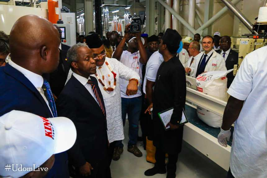 Gov Udom Emmanuel (on white) showing the Vice President Yemi Osinbajo around a newly constructed flour mill in the state