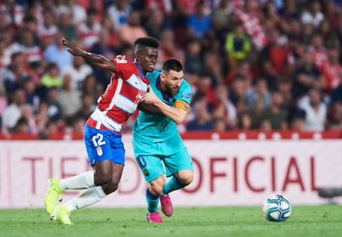 GRANADA, SPAIN - SEPTEMBER 21: Lionel Messi of FC Barcelona (R) duels for the ball with Ramon Azeez of Granada CF (L) during the Liga match between Granada CF and FC Barcelona at Estadio Nuevo Los Carmenes on September 21, 2019 in Granada, Spain. (Photo by Aitor Alcalde/Getty Images)
