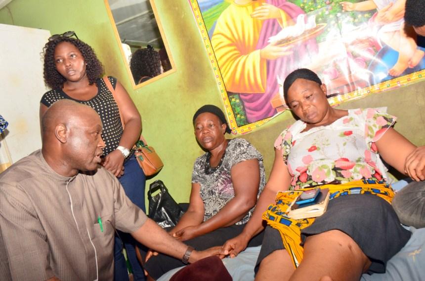 L-R: Secretary to Ekiti State Government, Hon. Biodun Oyebanji; consoling Mrs Esther Okunofua, Mother of the late Joseph Okunofua, when Ekiti State Government delegation paid a condolence visit to the family of the slain student of the Federal University, Oye-Ekiti; in Ido-Ekiti…on Friday