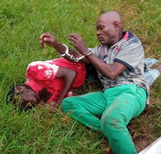 Wilson in handcuff with lifeless body of Okoro