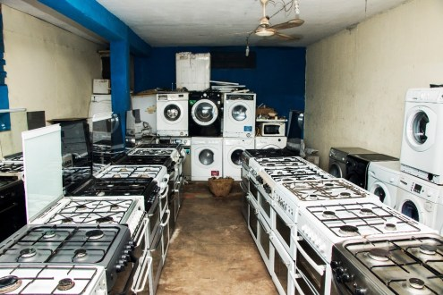 Used washing machines and gas burners at a store in Lagos, Nigeria. Credit: Hamed Adedeji