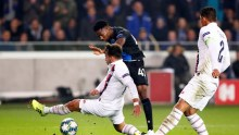 Club Brugge's Emmanuel Dennis shots at goal in UEFA Champions League match with PSG