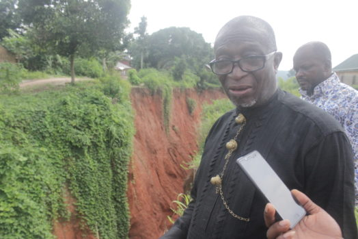 Princewill Nwaosuagu beside the gully