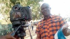 A respondent sharing his views on camera at Wuse market, Abuja