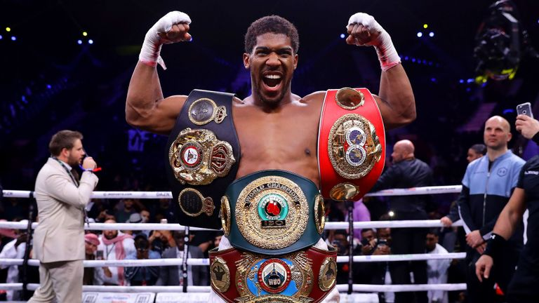 Anthony Joshua showing off his belts [Photo: Sky Sports]