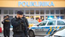 Police officers stand guard at the crime scene in front of a hospital in Ostrava, Czech Republic, where four people have been killed. EPA