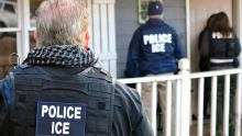 Police officials at the ICE. [PHOTO CREDIT: CNN]